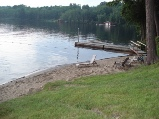 grand muskokan at sunny point resort has a seperate beach area with private dock for grand muskokan guests